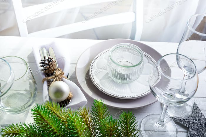 Christmas wreath with toys on the table with Silver Christmas Table Setting