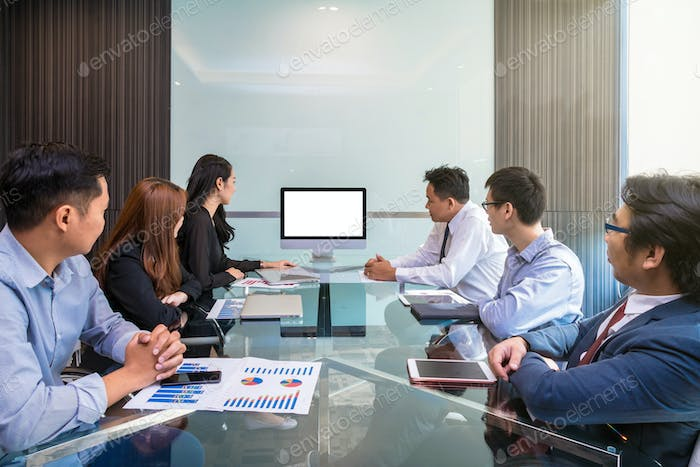 Group of asian Business team having video conference with monitor display