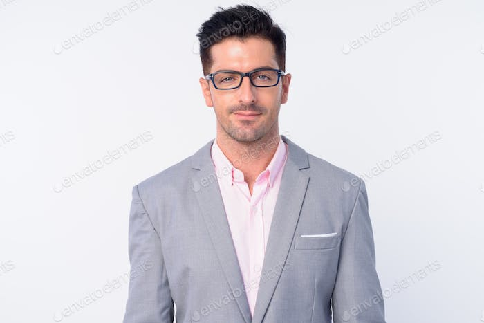 Face of young handsome businessman with eyeglasses
