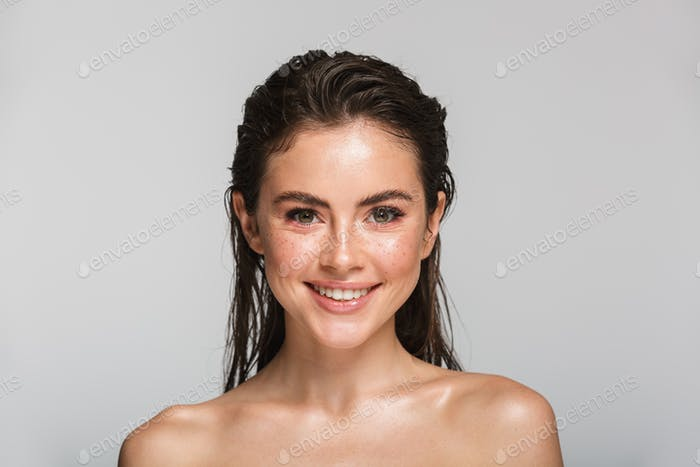 Beauty portrait of an attractive young topless brunette woman