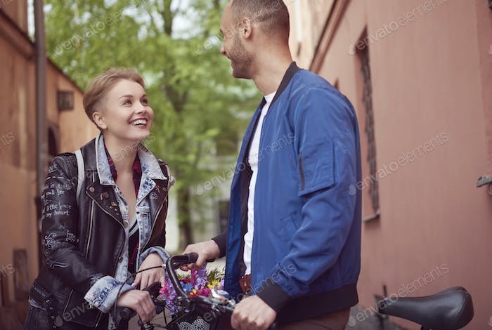 Beautiful young couple during cycling