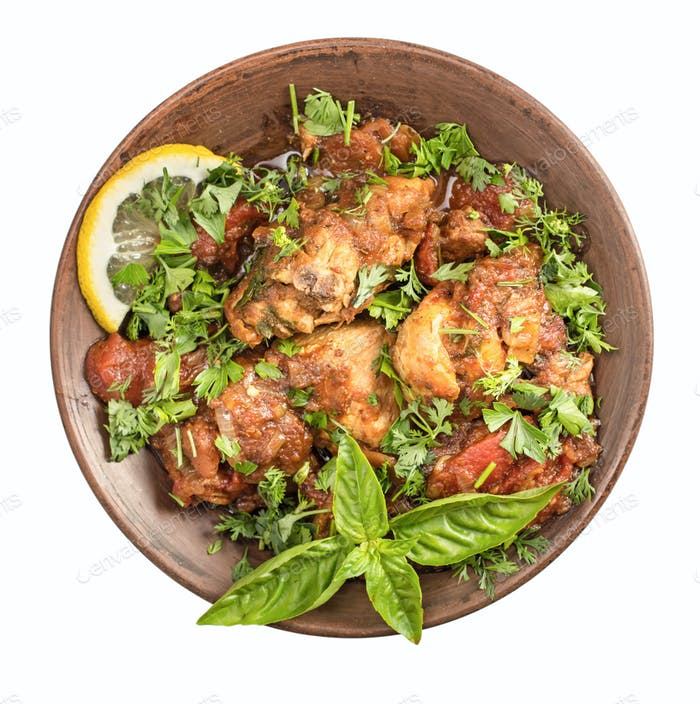 Chakhokhbili Chicken stewed with tomatoes and herbs isolated