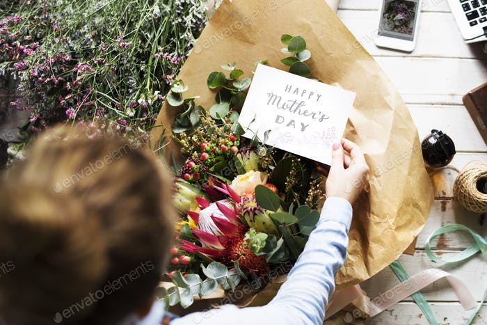 Florist Making Fresh Flowers Bouquet Arrangement with Happy Moth