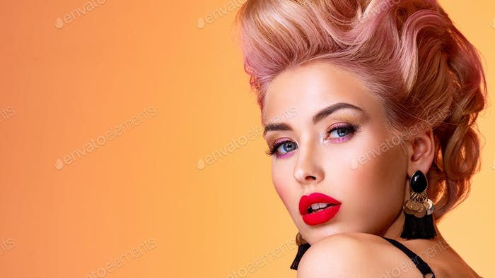 Beautiful woman with style hairstyle. White woman with bright colored makeup.