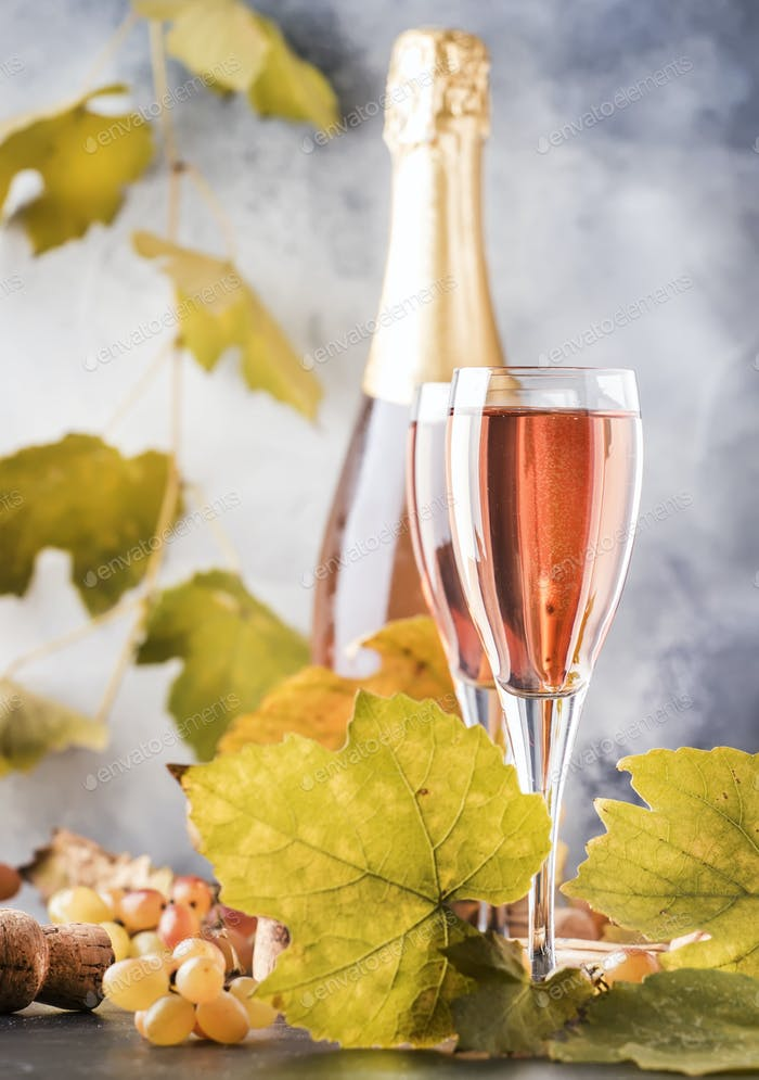 Rose pink champagne glasses and bottle