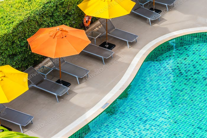 Beautiful outdoor swimming pool in hotel resort for holiday vaca