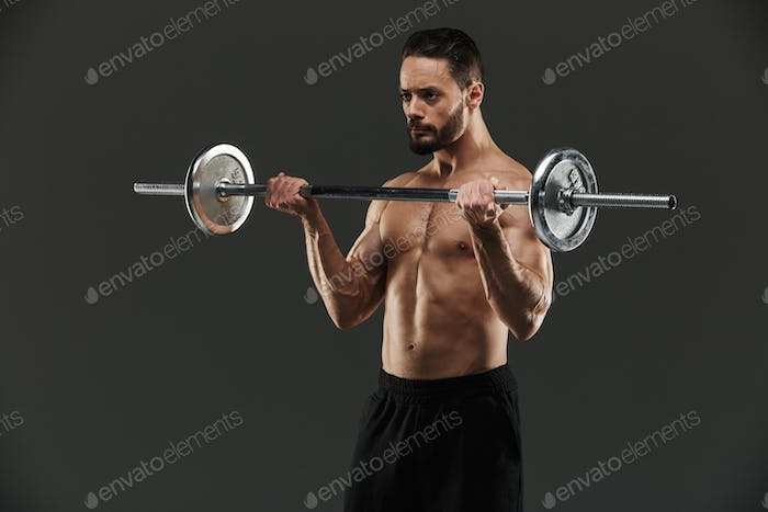 Portrait of a concentrated muscular bodybuilder