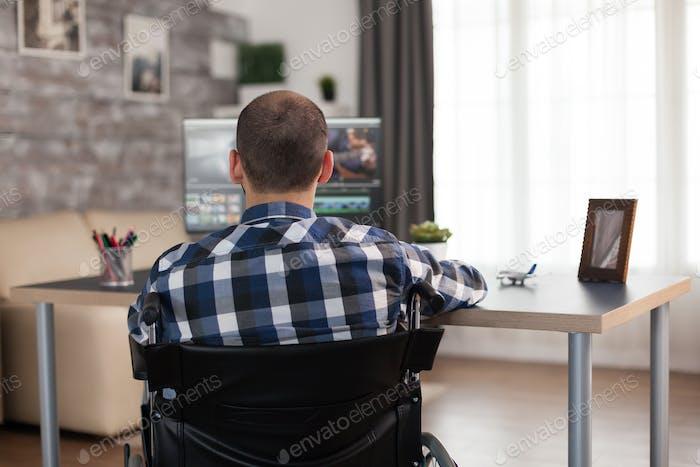 Video editor in wheelchair