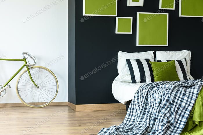 Black wall with green posters
