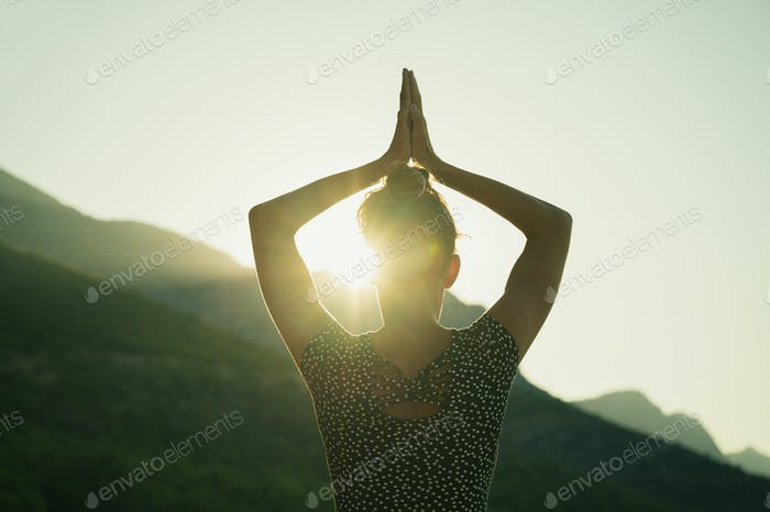 Woman making yoga asana in the morning