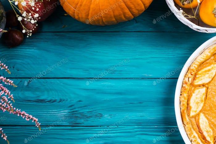 Autumn thanksgiving background with pumpkin pie