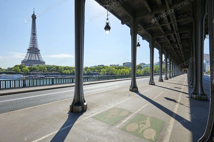 Bir Hakeim bridge and Eiffel tower in a sunny summer day in Paris