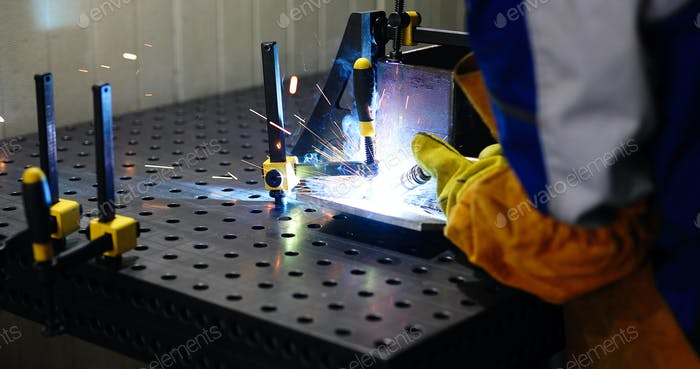 Metal cutting with acetylene torch in factory