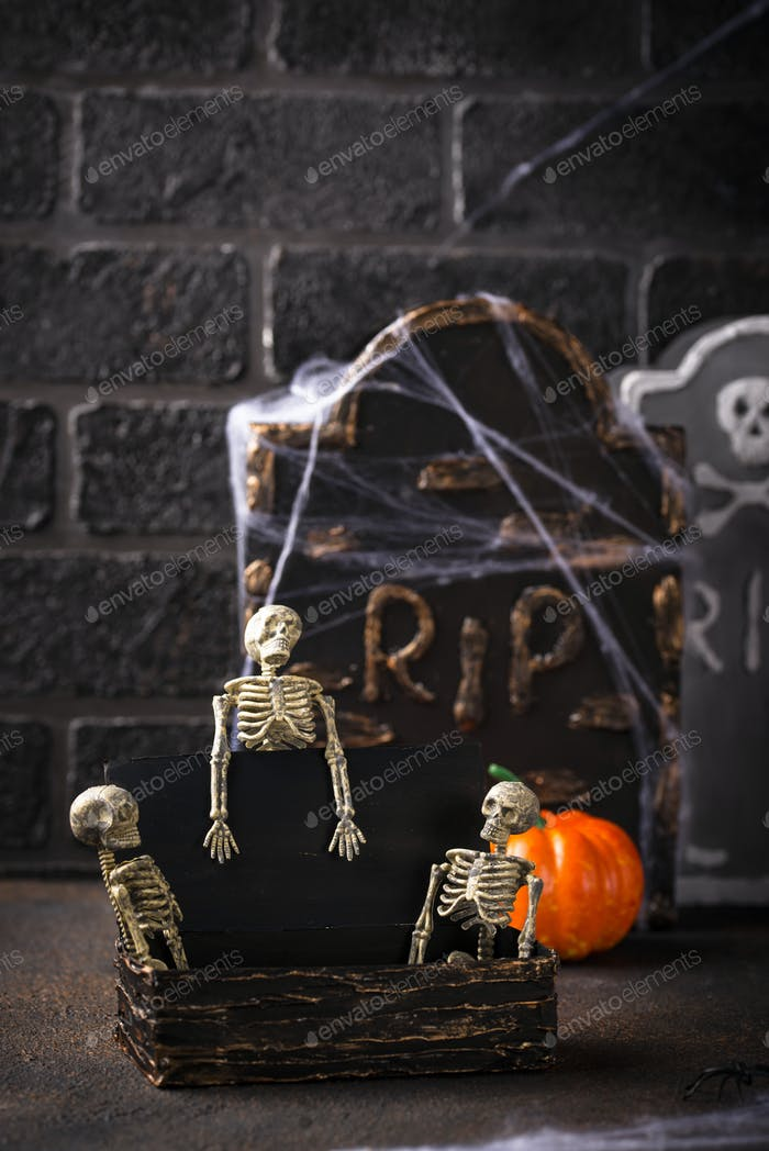 Halloween background with skeletons and tomb