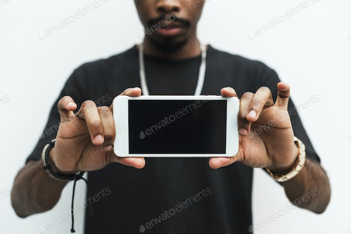 African man holding mobile phone mockup