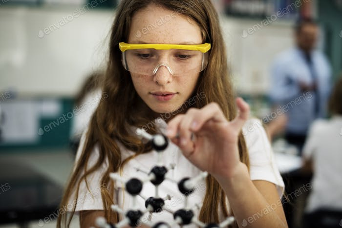 School girl learning science classroom