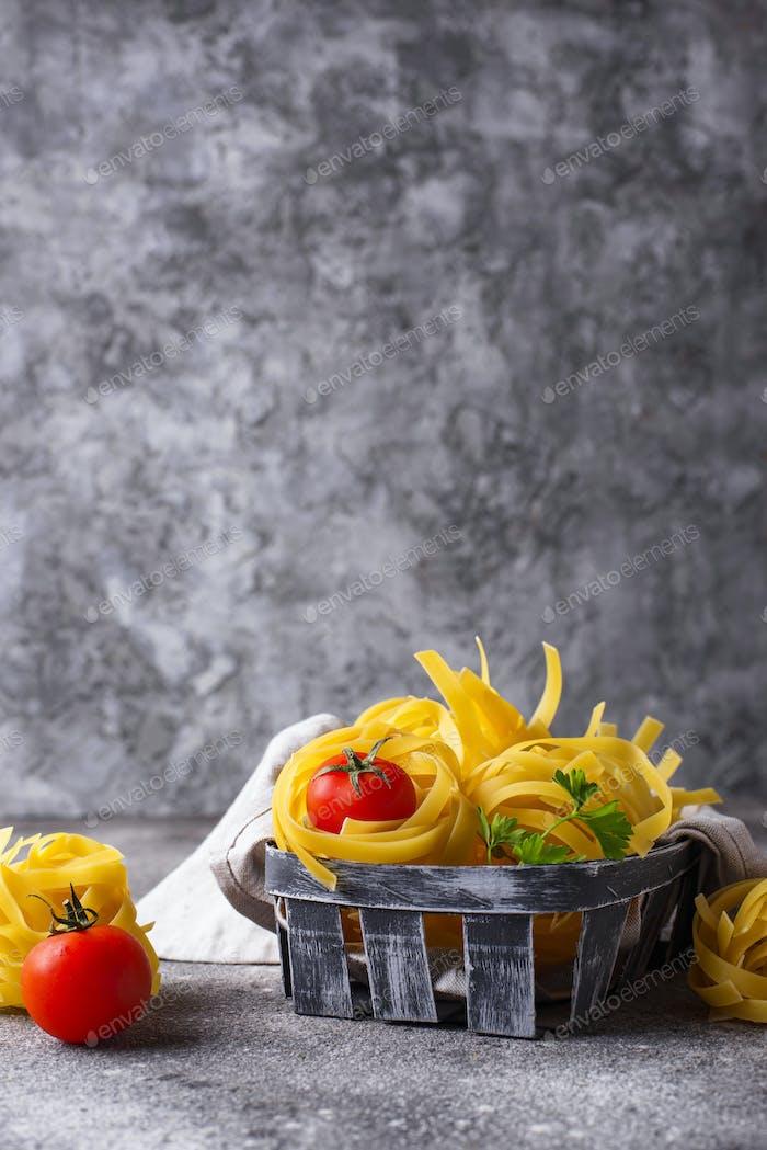 Raw pasta tagliatelle or fettuccine