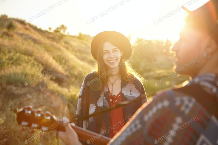 People, happiness, relaxation concept. Glad beautiful young female full of happiness looking at her