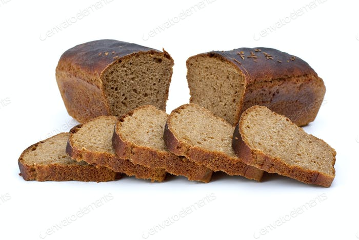 Two chunks of rye bread with anise and some slices