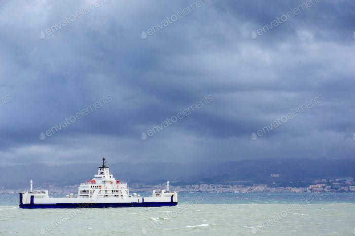 ship at sea under dramatic clouds Sicily Italy Europe