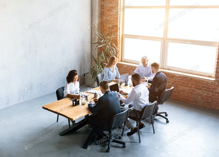 Multiracial Business Team Working Sitting At Desk In Office, High-Angle