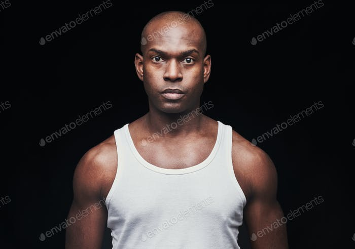 Serious young black man in undershirt