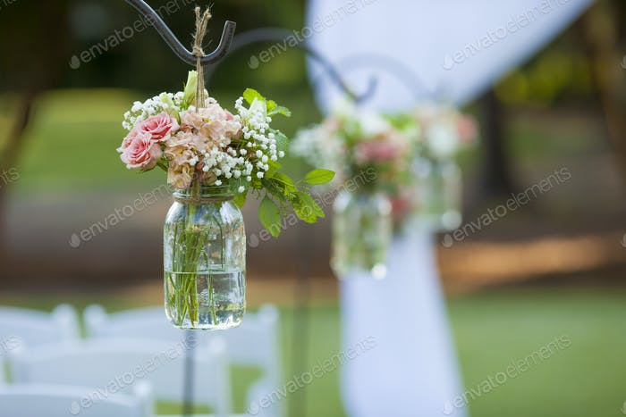 Flowers and mason jar at wedding