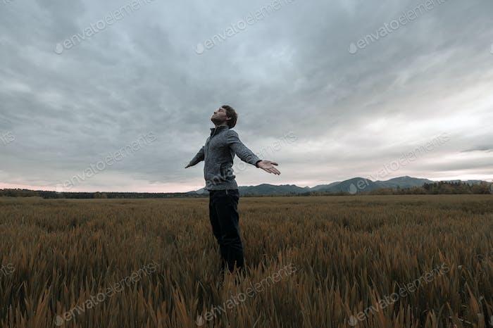 Young man embracing life