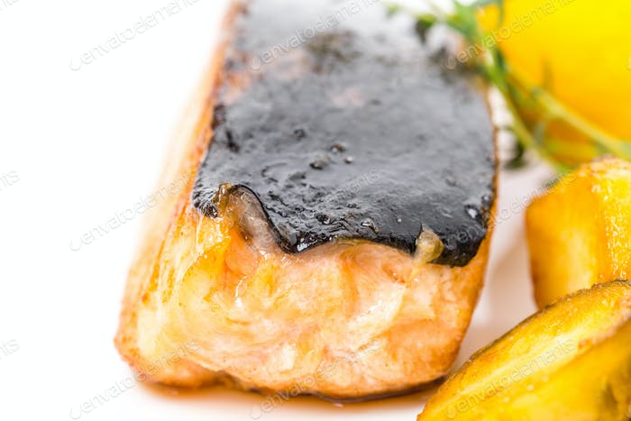 Grilled salmon fillet with brussel sprouts.