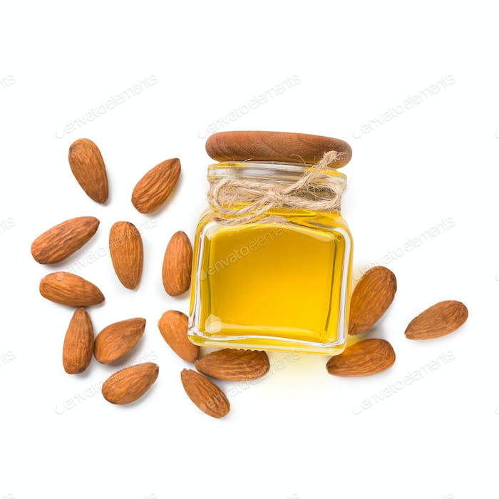 Almond oil in bottle on white
