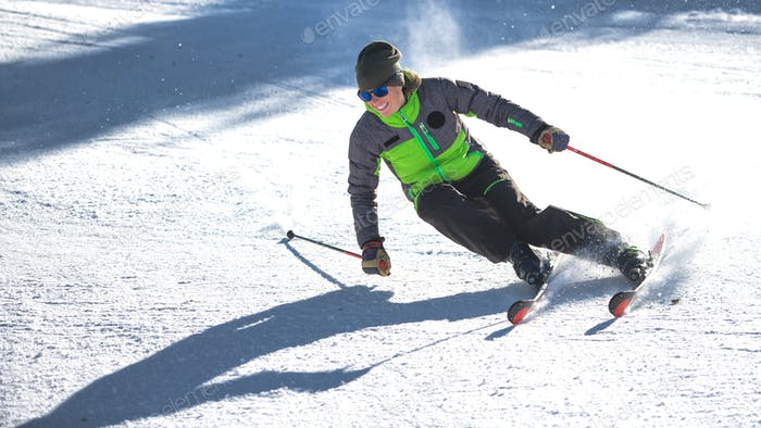 Carving curve of a girl ski