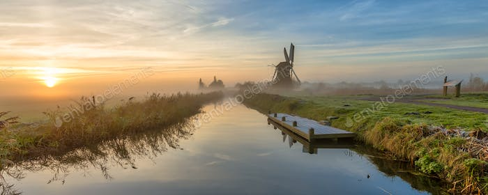 Windmill along dutch canal