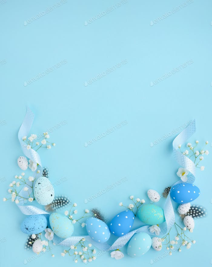 Easter eggs on a blue background with empty space. Easter card.