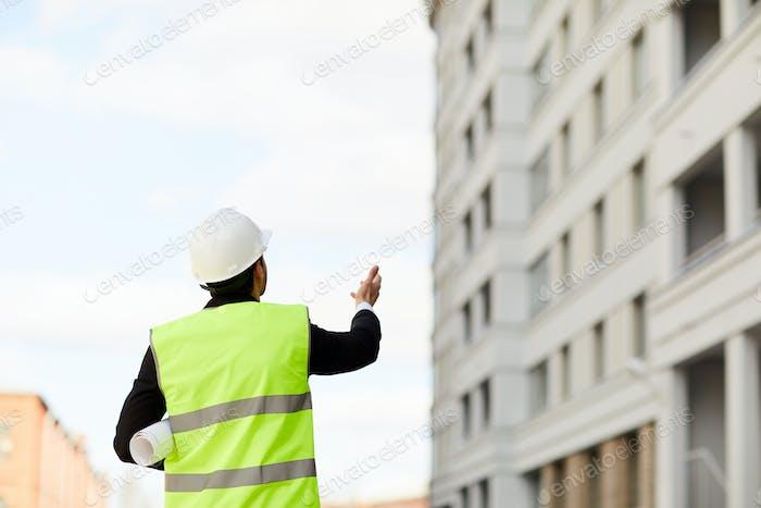 Unrecognizable Worker at Construction Site