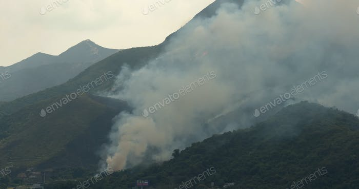 Tin Shui Wai, Hong Kong, 05 April 2018:-Serious of Fire accident on mountain with helicopter rescue