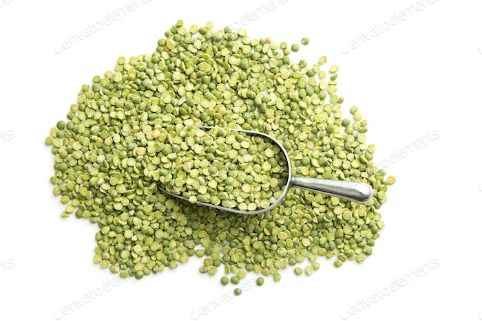 Green split peas in metal scoop.