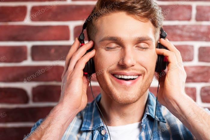 Enjoying music.