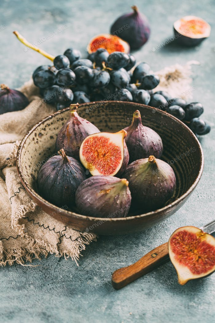 Fresh ripe figs and grapes in a bowl
