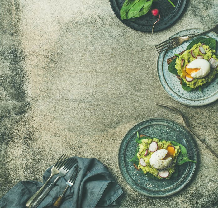 Healthy vegetarian wholegrain avocado toasts with poached egg, copy space
