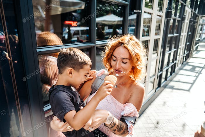 mom and son eat ice cream together