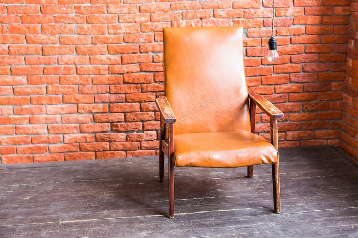 Armchair On Brick Wall Background