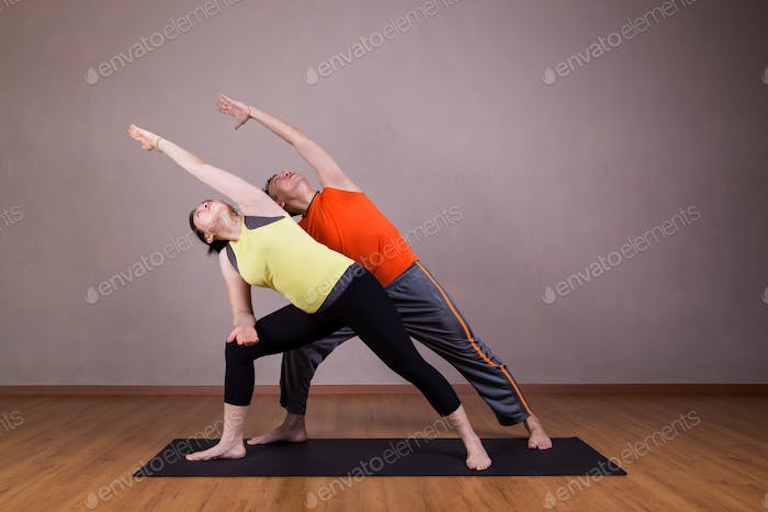 Couple perform series of Extended Side Angle yoga partner pose