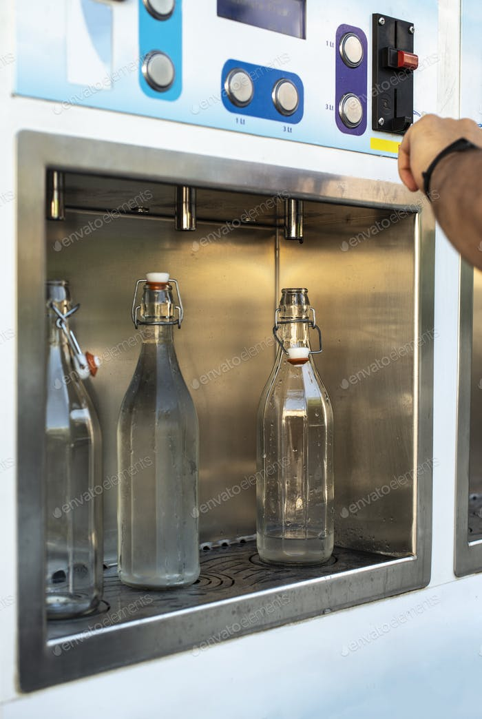 Mineral Water machine on the street. Pay and load drinking water