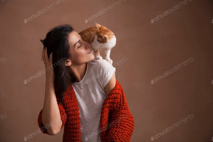 Little kitten on woman shoulder