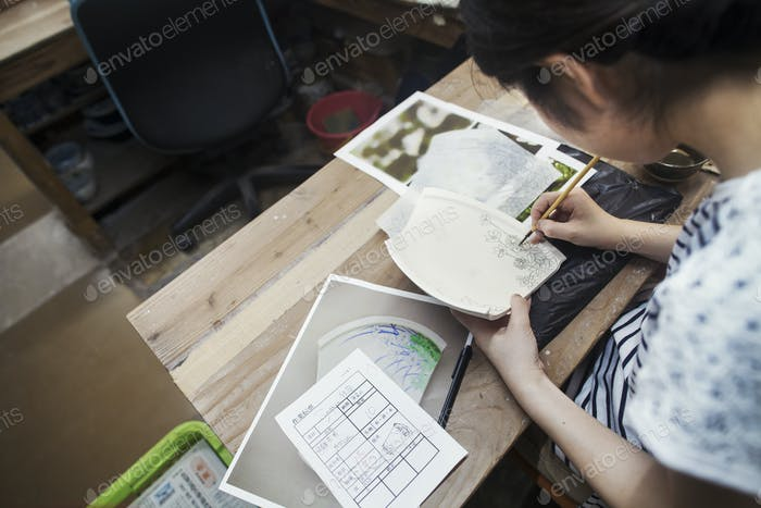 Woman working in a Japanese porcelain workshop