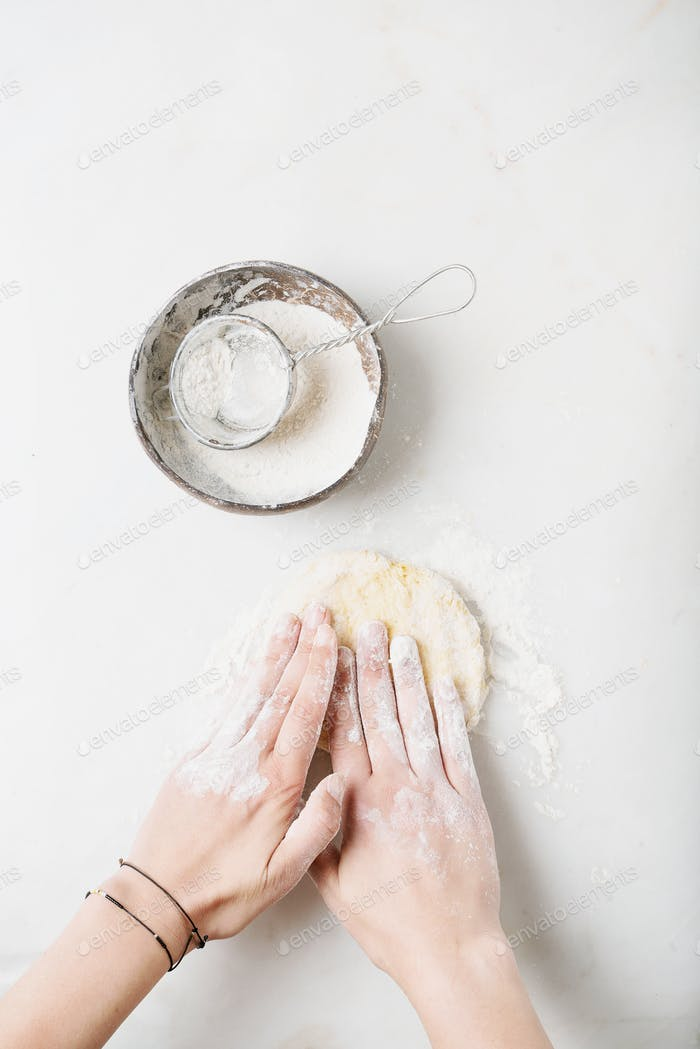Dough Making Process. Female hands kneading the dough.