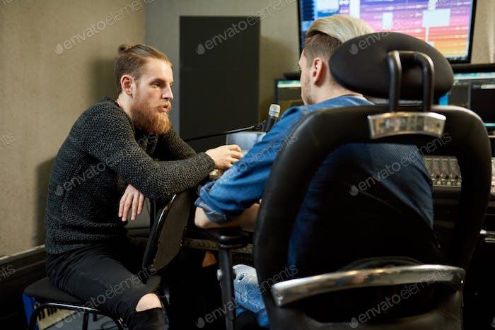 Sound studio workers having talk