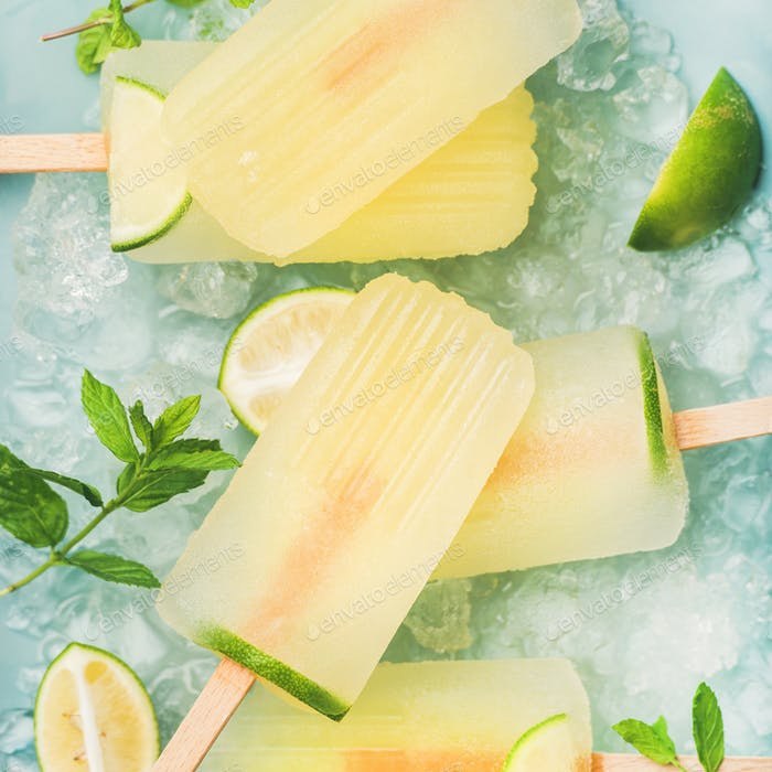 Summer lemonade popsicles with lime and chipped ice, square crop