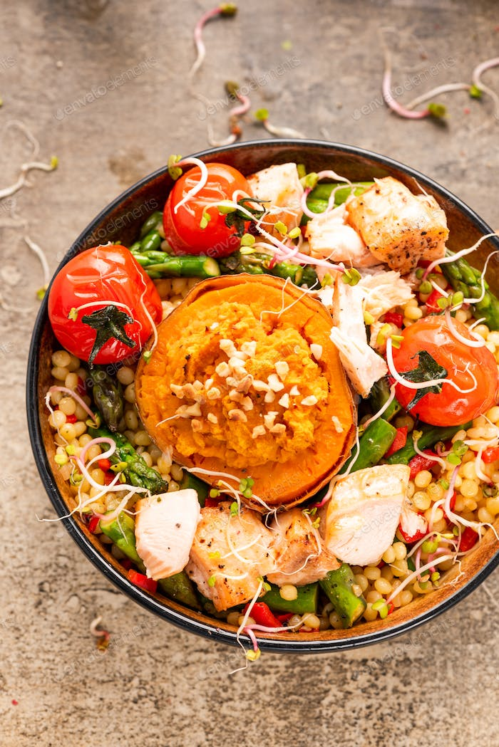 Stuffed Sweet Potato with Couscous and Vegetables in Bowl