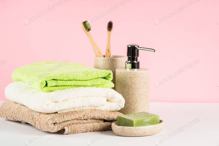 Bathroom background with ceramic soap and towels at the table